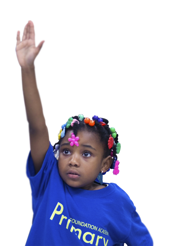 The photo shows a primary school student with her hand raised to answer a question.