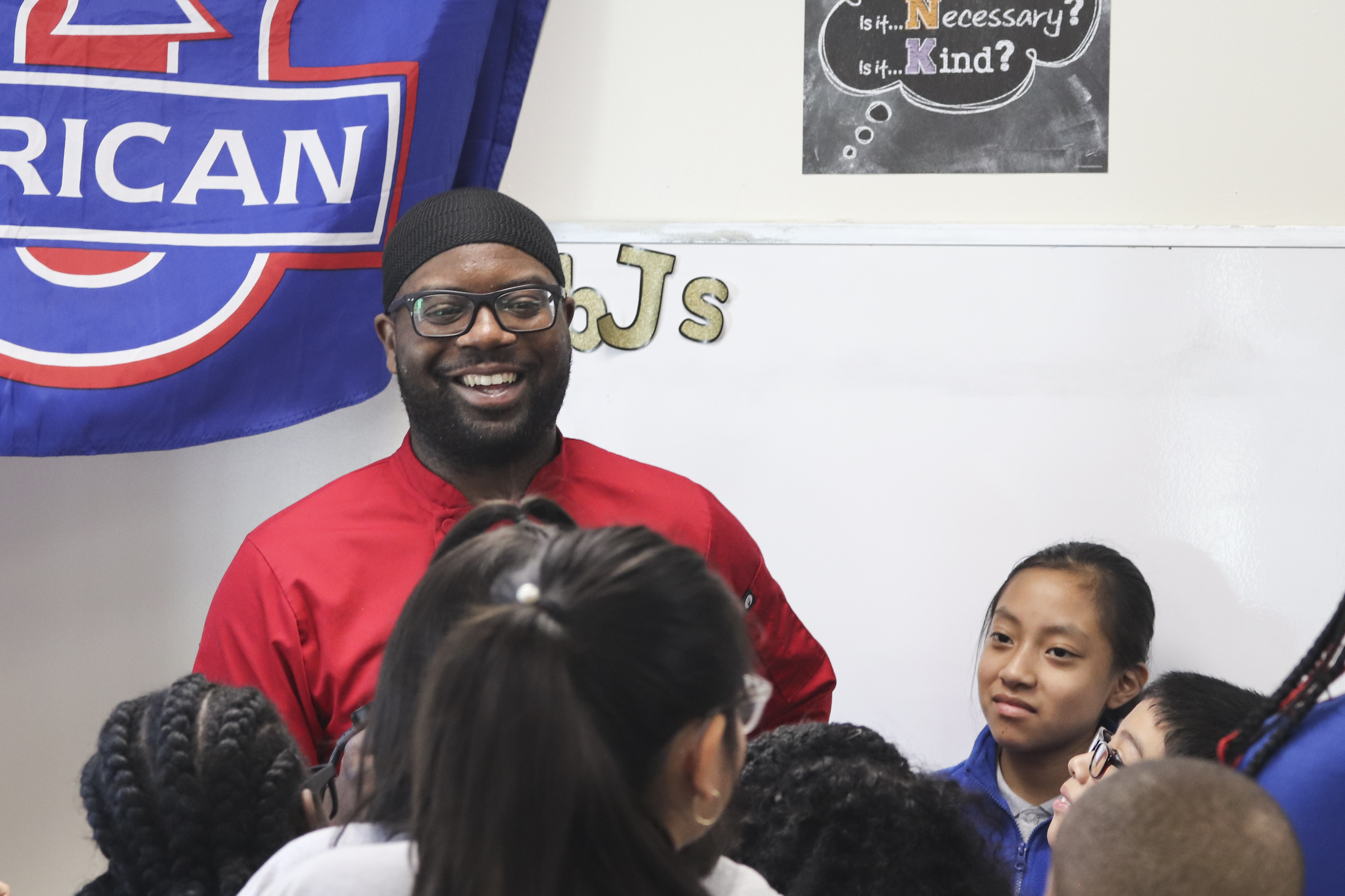 Chef Black smiles as he fields questions from curious students.