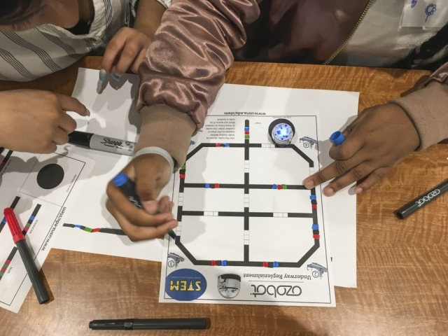 Working together on their Ozobot projects.