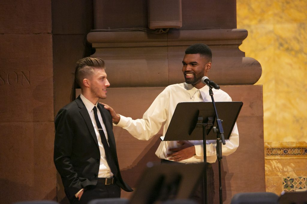 FCA Class of 2019 Alum Justin Polanco jokes with Strings Program Director Ryan Kiple during the concert