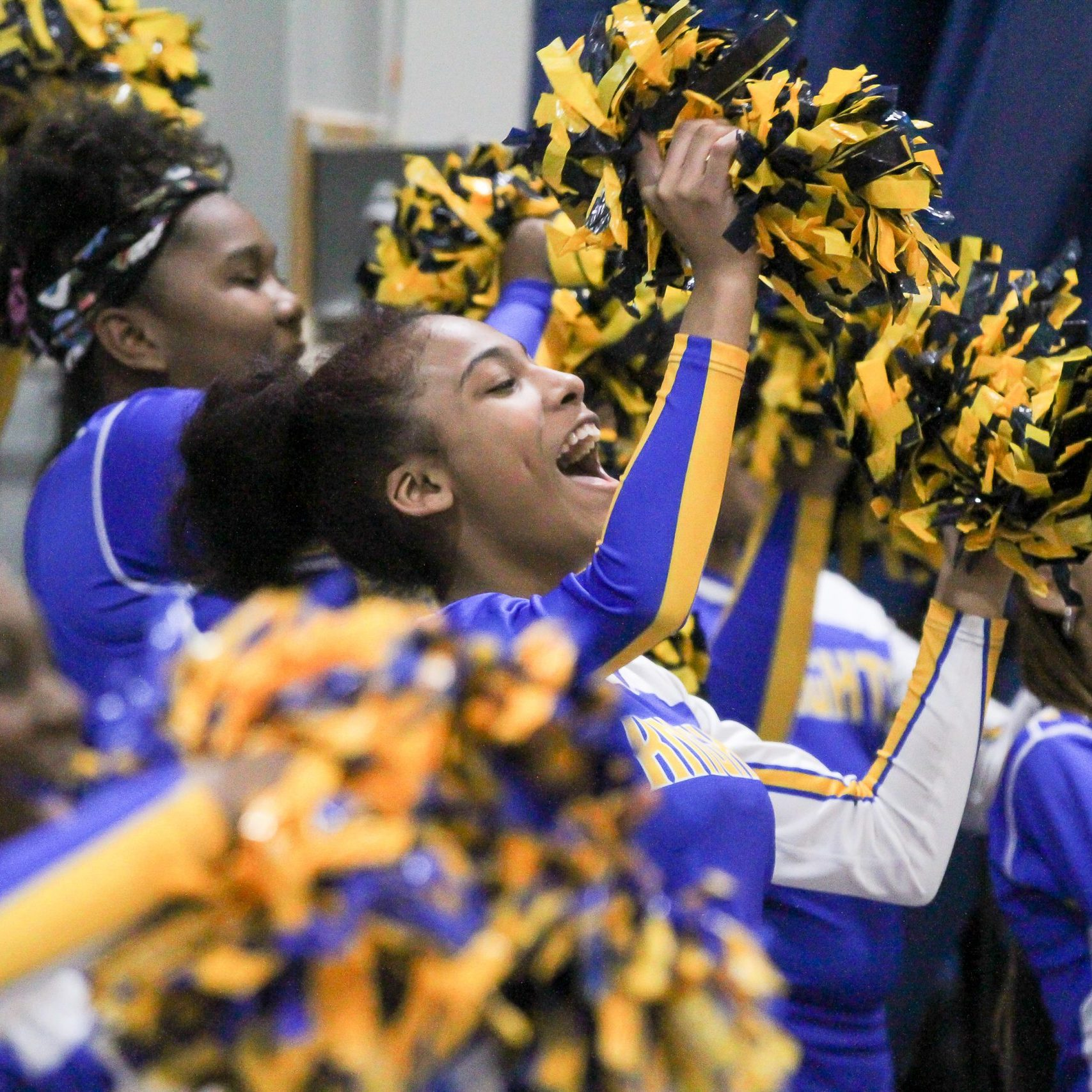 Foundation Academy's Middle School Cheerleading Squad cheers on the Boys Basketball Team