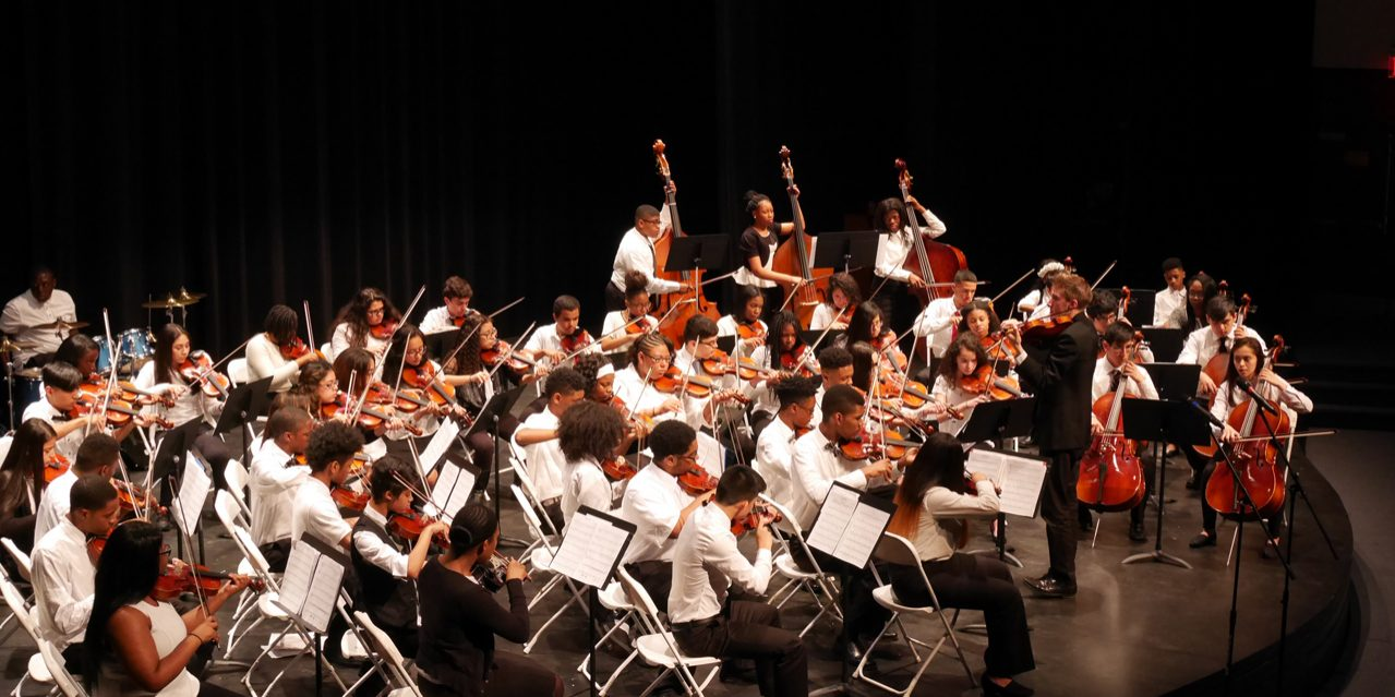 The photo shows the strings orchestra performing its spring concert.